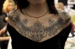 A-beautiful-lace-collar-tattoo-that-uses-hearts-and-roses-to-symbolize-love-and-passion