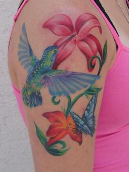 A-hummingbird-butterfly-and-flowers-make-up-this-beautiful-tattoo-a-perfect-tattoo-design-for-women-or-girls