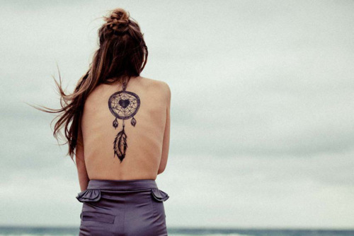 A-large-dreamcatcher-tattoo-with-a-heart-at-its-center-and-a-hanging-feather