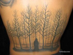 Tattoo-of-a-forest-of-dead-trees.-Spooky-body-art-design.