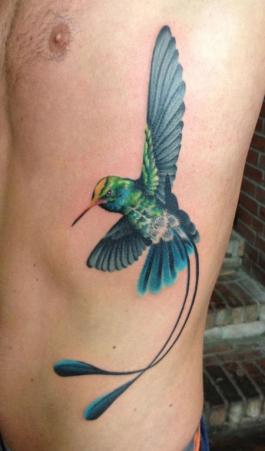 This-hummingbird-tattoo-design-has-extra-tail-feathers-to-create-a-fantasy-hummingbird-design